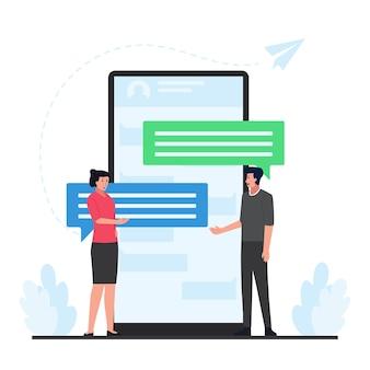 男性と女性は、オンライン会話のメタファーの背後にある電話で大きなバブルチャットでお互いに話します。