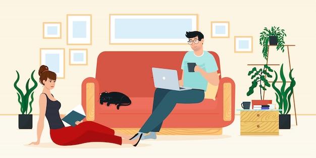 ラップトップを持つ男と女はソファーに座っています。