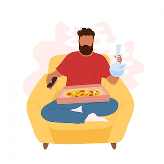 Man in armchair smoking weed from bong