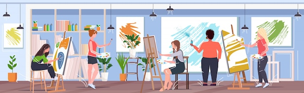 Man artists using aerosol spray women with paintbrush drawing pictures painters working together creative occupation concept modern art studio interior horizontal banner