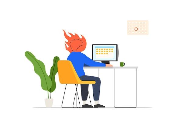 Человек за столом с компьютером