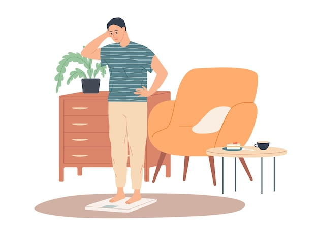 Мужчина дома стоит на весах и недоуменно смотрит на них. он прибавил в весе.