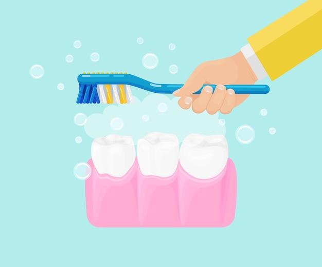 Мужчина чистит зубы зубной щеткой с зубной пастой
