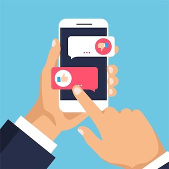 Мужчина выбирает, нравится или не нравится на дисплее телефона нажмите кнопку, палец вверх или палец вниз