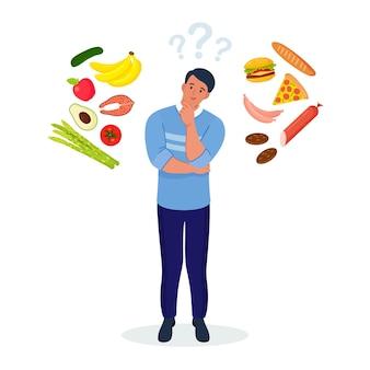 건강한 음식과 건강에 해로운 음식 사이에서 선택하는 남자. 패스트푸드와 균형잡힌 메뉴 비교, 다이어트. 좋은 영양과 나쁜 영양 사이의 선택
