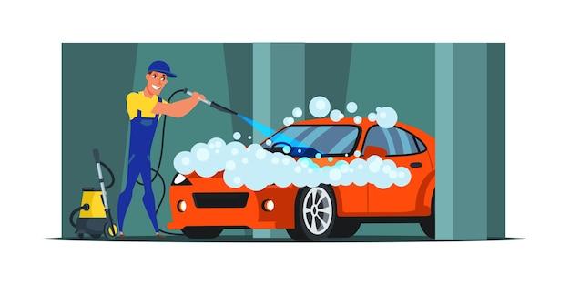 Мужчина чистит роскошный красный автомобиль