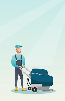 기계로 매장 바닥을 청소하는 사람.