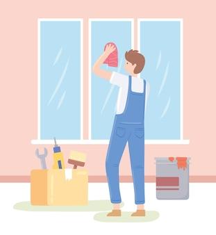 窓を掃除する人