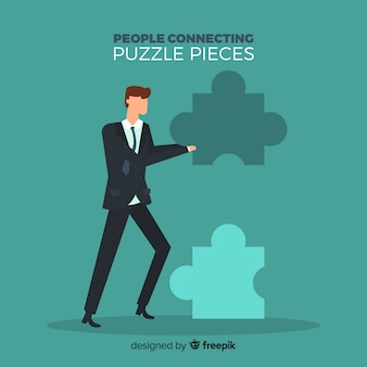 Man connecting puzzle pieces background