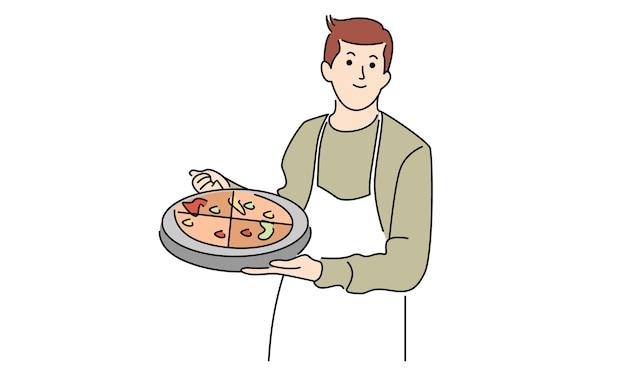 男はピザとトレイを調理し、保持します