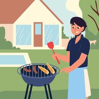 Человек готовит барбекю на заднем дворе