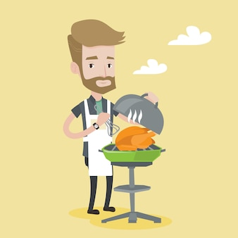 Man cooking chicken on barbecue grill.