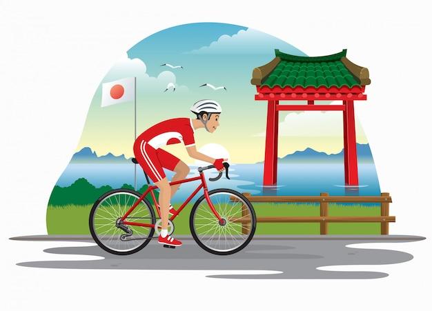 Человек на велосипеде в японии с фоном японские ворота