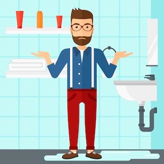Man in despair standing near leaking sink.