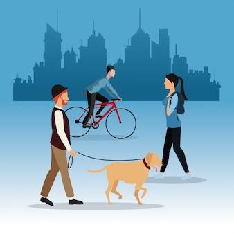 歩く男の犬の少女と男の乗り物のバイクの街の背景
