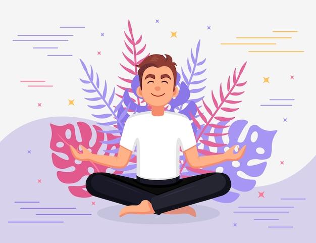 ヨガをしている男。パドマサナ蓮華座に座って、瞑想し、リラックスし、落ち着いて、ストレスを管理するヨギ