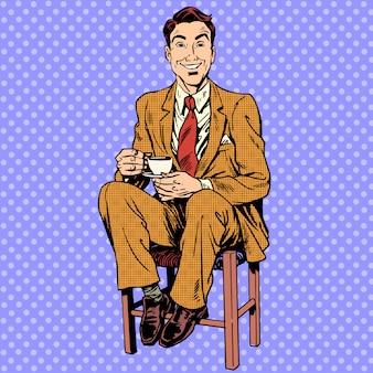 スツールに座ってお茶を飲む男性