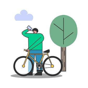 공원에서 자전거를 타는 동안 스포츠 병에서 물을 마시는 사람. 남성 운동 자전거