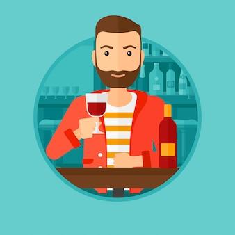 レストランでワインを飲む人。