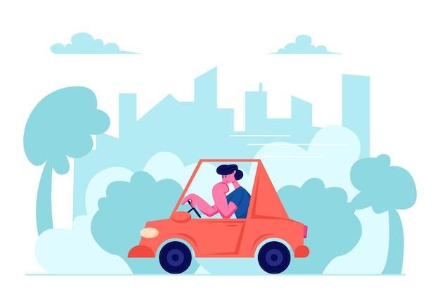 都市の街並みで車を運転する男
