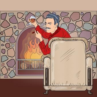 Человек, наслаждающийся сигарой и напитком