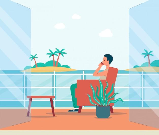 발코니 또는 야외 테라스에서 바다 전망을 즐기는 남자.