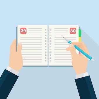 日記、プランナーまたはノートブックを埋める男。リスト、リマインダー、スケジュール、または議題のためのオフィスおよびビジネス用品