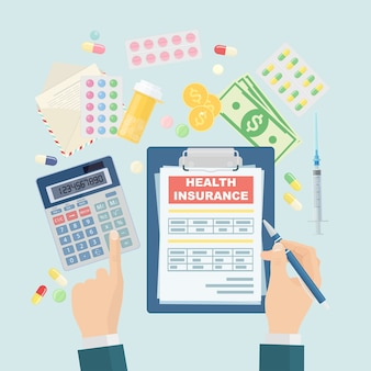 Man fills in the form of health insurance. healthcare concept. claim form. pills bottle and money