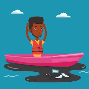 오염 된 물에서 보트에 떠있는 남자.
