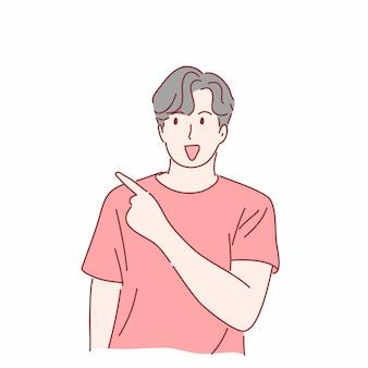 手描きの何かを指して身振りで示す男