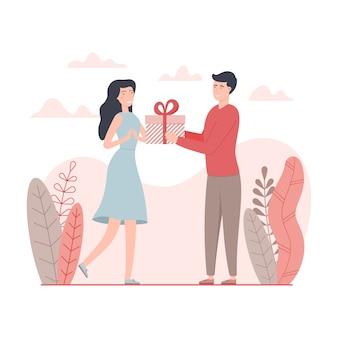 Мужчина дарит подарок женщине на день святого валентина.