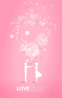 Man give gift box to girlfriend with flying music note. concept background for song and love music concert theme.