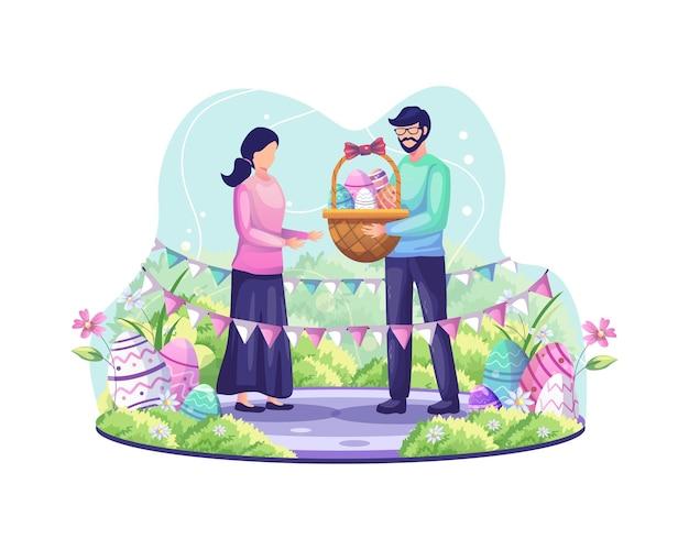 男は女の子にイースターエッグがいっぱい入ったバスケットを渡します。カップルがイースターの日のイラストを祝う