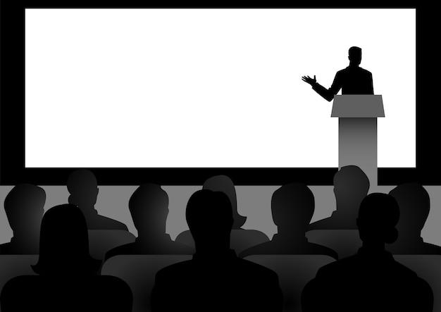 Человек дает речь на сцене