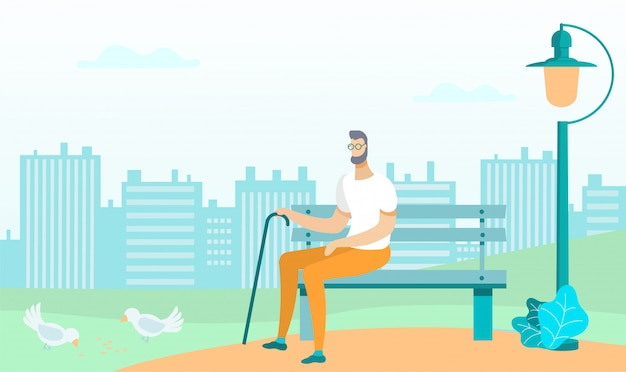 Man in glasses with stick sits on bench in park.