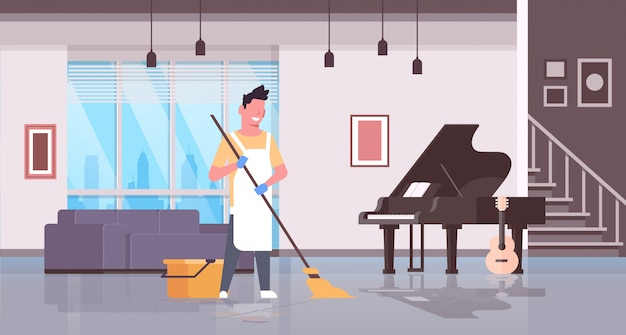 Man in gloves and apron washing floor guy using mop doing housework cleaning concept modern house living room interior