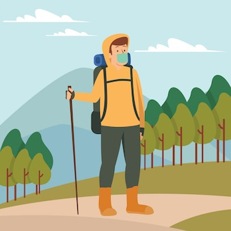 A man going hiking alone while keep using medical mask