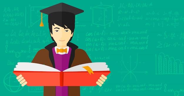 Man in graduation cap holding book