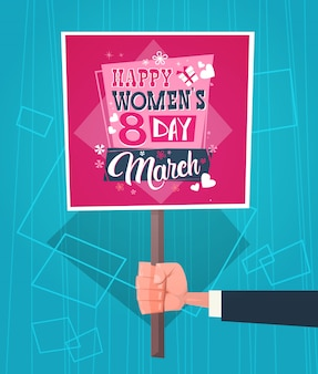 Man hand holding banner with happy women day greeting on abstract blue retro style