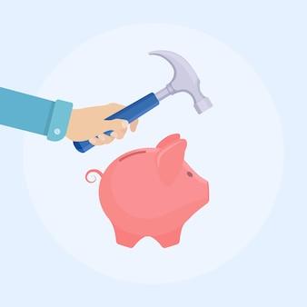 Рука человека держит молоток, поднятый над копилкой с деньгами, чтобы разбить его