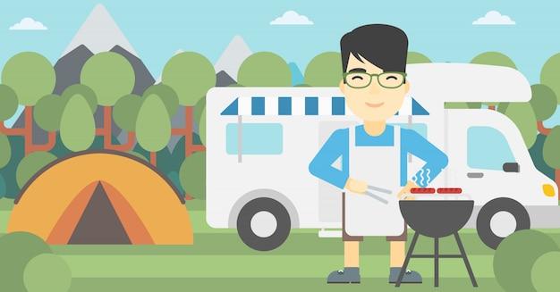 Man having barbecue in front of camper van.