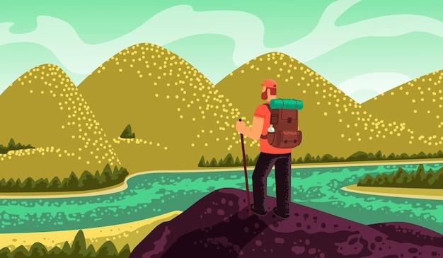 Путешественник, стоит на вершине и смотрит на горы и реку. концепция исследования и открытия нового.