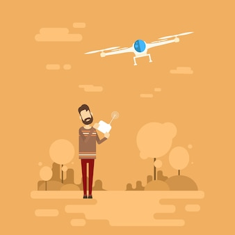 Man hipster hold remote control drone