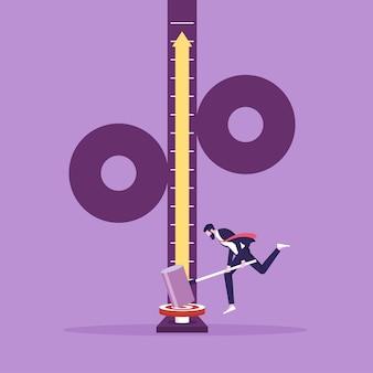 ビジネスの割合の増加を描いたハンマーで強度テスターのターゲットを打つ男