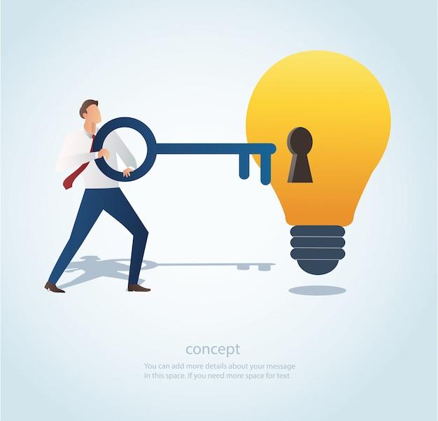 Man holding big key with keyhole on the lightbulb