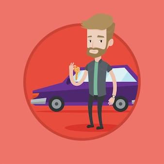 彼の新しい車の鍵を握る男。