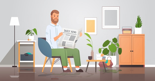 Man holding newspaper reading daily news press mass media concept businessman sitting on armchair