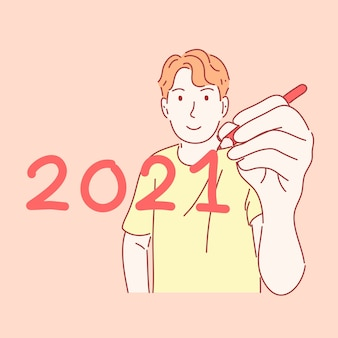 Мужчина держит ручку и пишет новогоднюю концепцию в рисованной