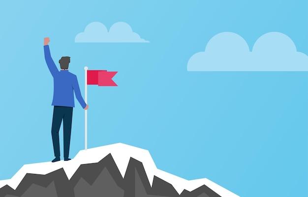 산 그림 위에 붉은 깃발을 들고 있는 남자. 성공적인 개념
