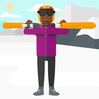 Man holding skis